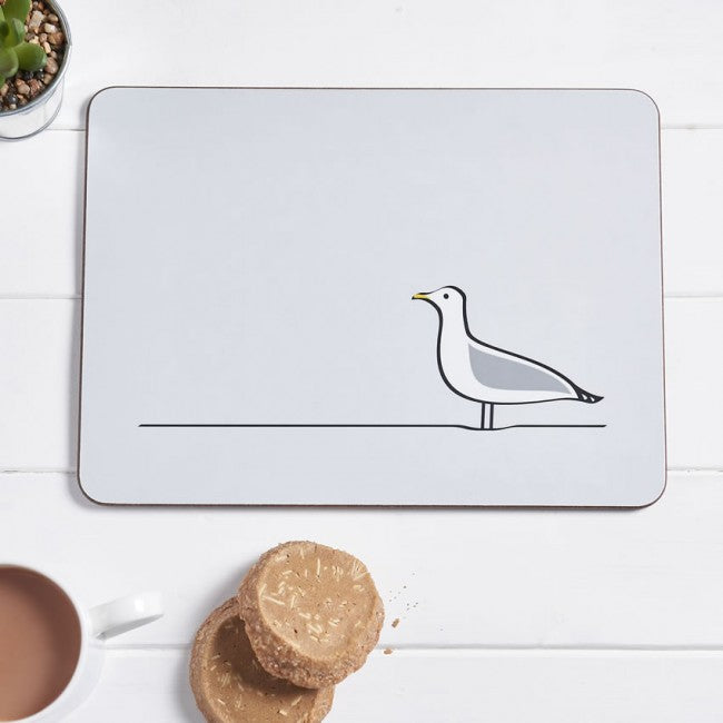 Seagull Placemat with cup of tea and biscuits