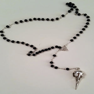 Bird skull rosary, Roman and Minnie