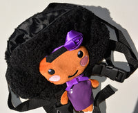 African American Backpack Doll (Purple Dress) Side View