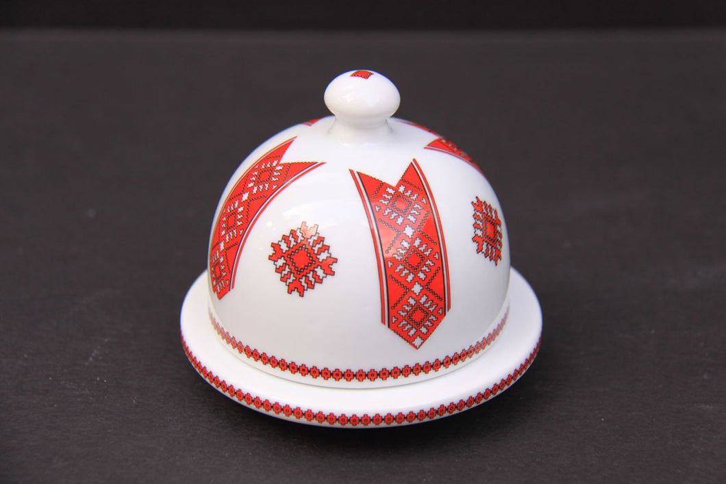 small round covered butter dish