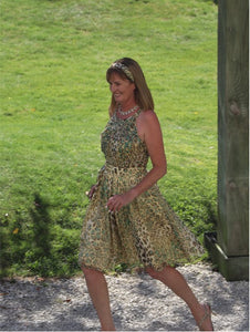 CHAMPAGNE AND TURQUIOSE LEOPARD PRINT SILK DRESS WITH SELF BELT AND HEADBAND.