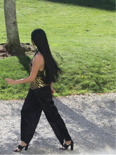 Load image into Gallery viewer, GOLD AND BLACK SEQUIN STRETCH HALTER NECK TOP WITH V SHAPED PEPLUM WITH WIDE LEG PANTS