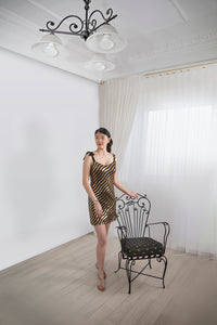 GOLD & BLACK SEQUINNED COCKTAIL DRESS Cut on the angle with one shoulder tie silk bow.