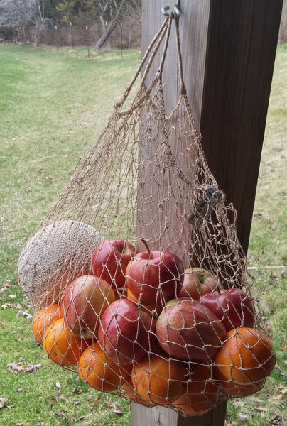 Lao Market Eco-Friendly Mesh Net Bag, stretchy and strong, holding fruit produce.