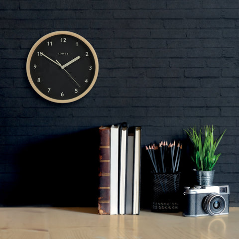 modern wall clock with black dial by Jones clocks
