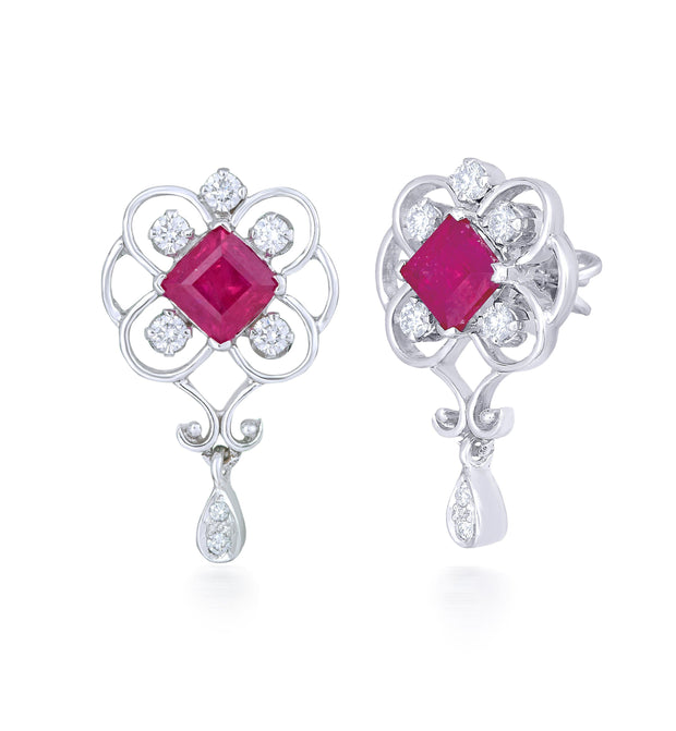 18kt White Gold Dangling Diamond Earrings With Red Sapphire In The Center .