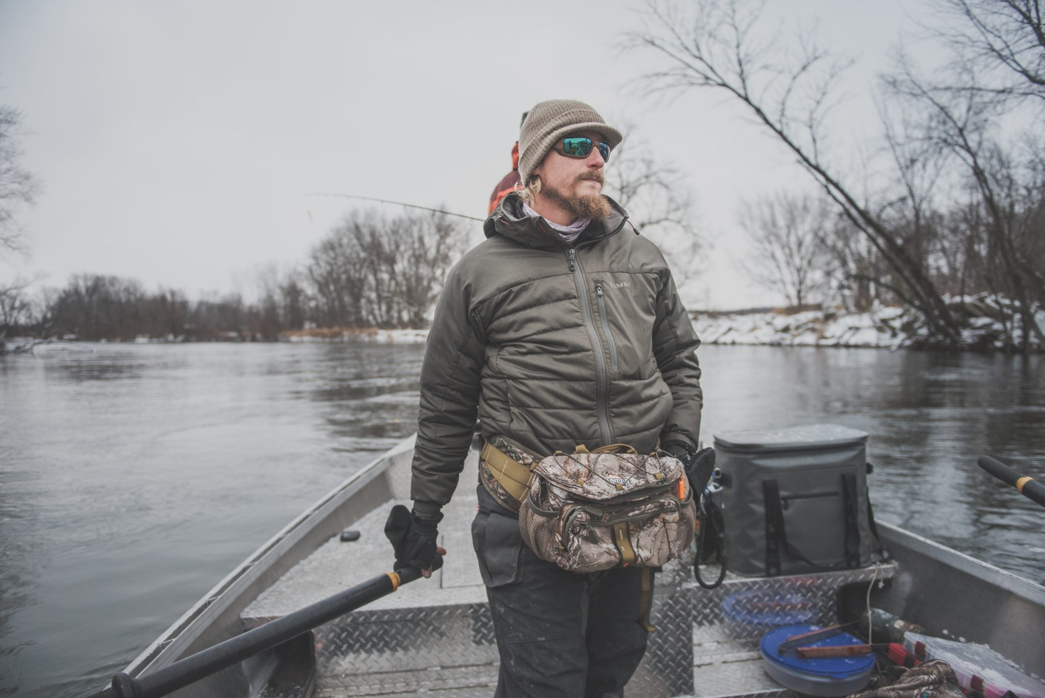 Michigan resident, and Fishing Guide, Brandyn Thorsen, with Great Lakes Guide Services, uses the Pioneer 400RT series waist pack, while guiding a Steelhead trip on the Muskegon River in Michigan. The Pioneer 400RT is perfect for cold weather as it doubles as a hand warmer.