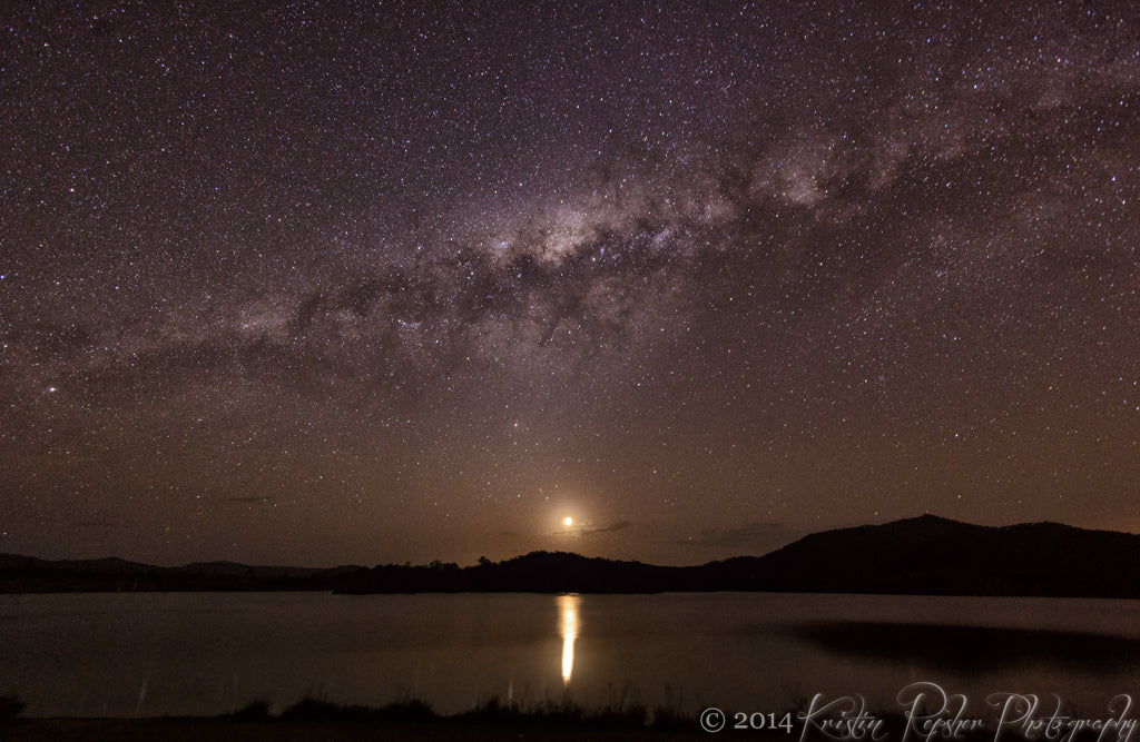 The Milky Way stretches across the sky, high above Lake Wyaralong and the setting, nearly-new moon. The moon was actually only a tiny sliver, which is why its light didn't hide the stars.