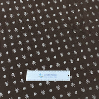 Silver Skulls on Brown Cotton/Spandex Jersey - Nature's Fabrics
