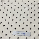 Small Black Skulls on White Cotton/Spandex Jersey - Nature's Fabrics