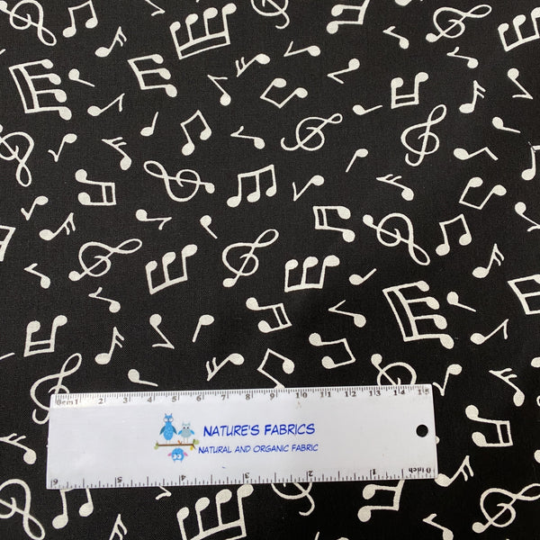 White Music Notes on Black 100% Cotton Woven - Nature's Fabrics