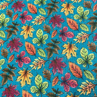 Fall Leaves on Teal Bullet Knit - Nature's Fabrics