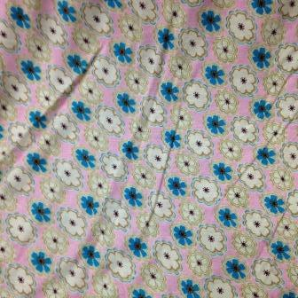 Blue and Natural Flowers on Pink Cotton/Poly Jersey