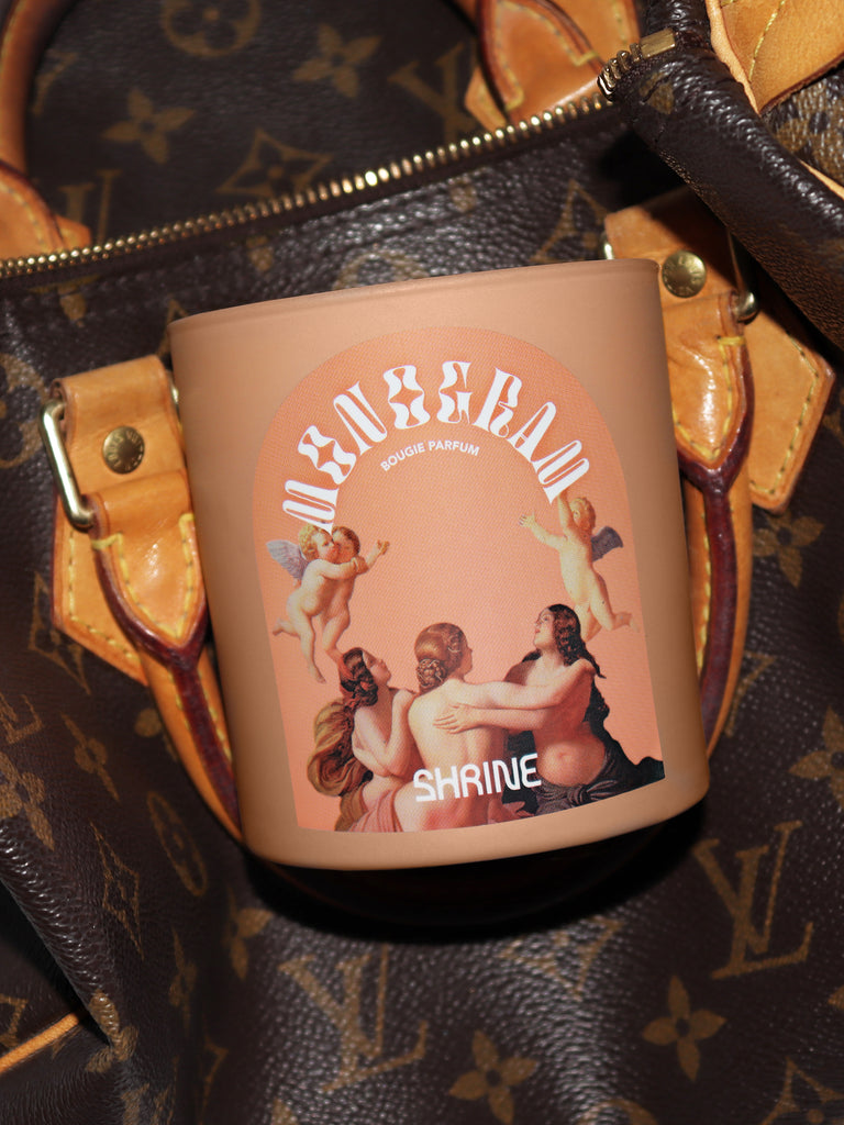 shrine monogram monochromatic nude angel cherub candle with monogram purse shop shrine