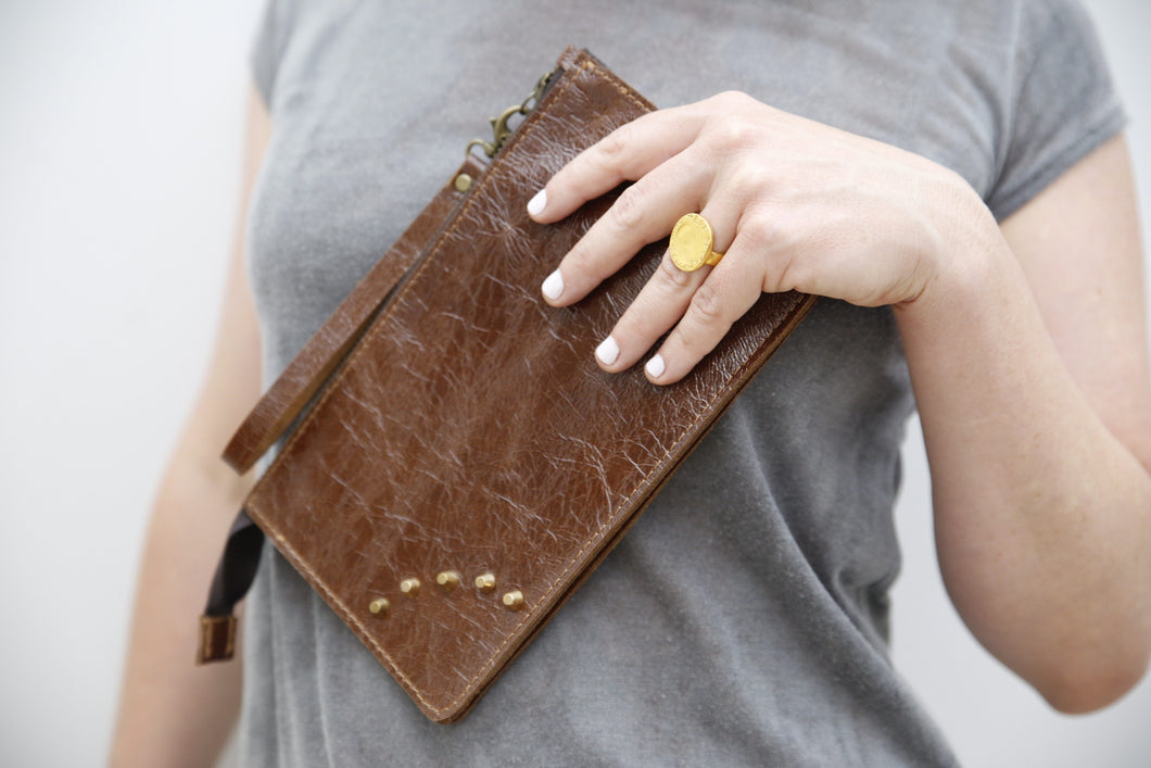 Brown leather mini clutch