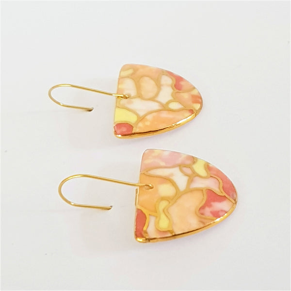 D dangle earrings in warm tones with gold linework and edging