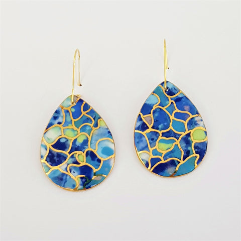 Drop earrings in multi blues with gold linework.