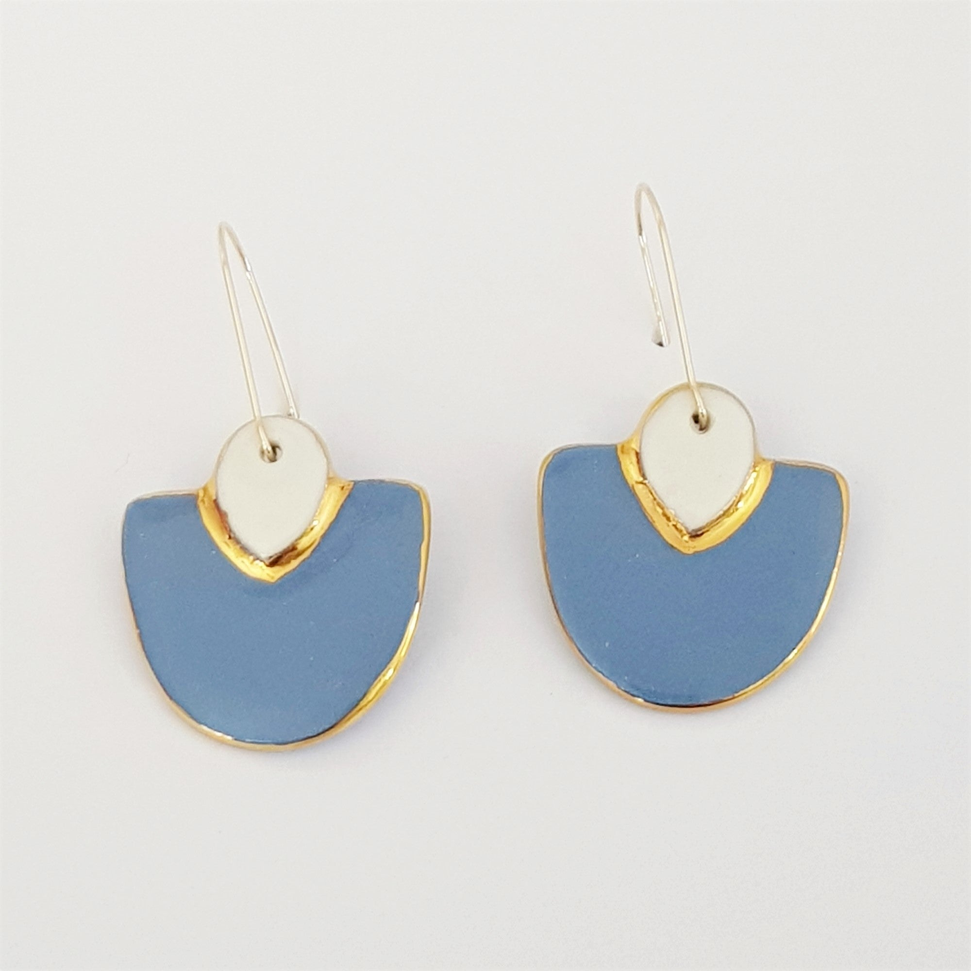 Two toned elegant drops in blue-gray and white with gold border.
