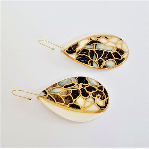 Big black and white porcelain drops shaped earrings with gold detailing