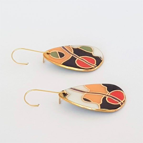 Porcelain dangles in bold abstract design with gold linework