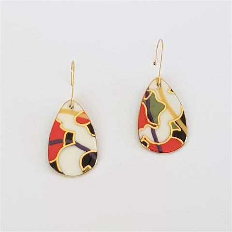 dangle earrings in abstract pattern with gold