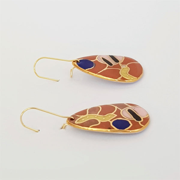 Dangle earrings, rust and blue abstract pattern with gold linework.