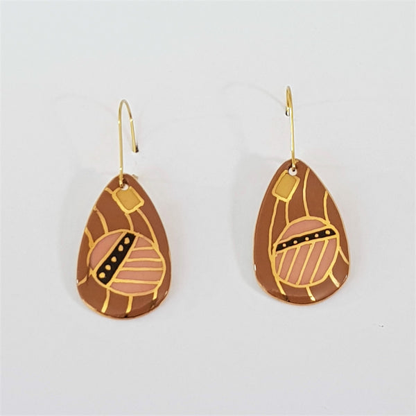 dangle earrings in earthy tones