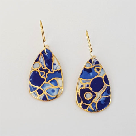 Dangle earrings indigo tones with gold linework.