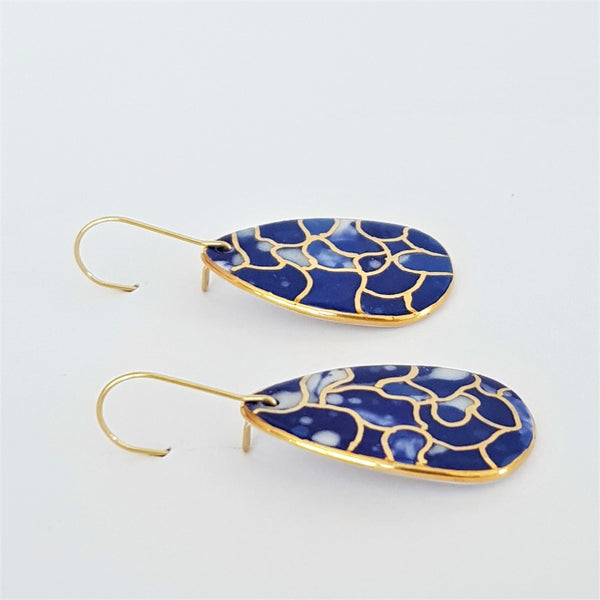 Porcelain dangle earrings in indigo tones with gold linework