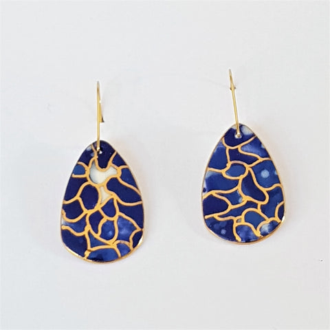 Porcelain dangle earrings in indigo tones with  22 kt gold linework