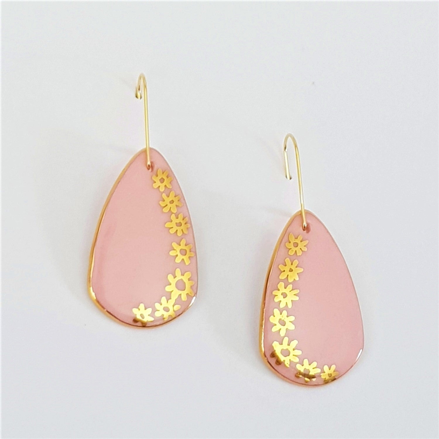 Soft pink porcelain earrings with gold daisies
