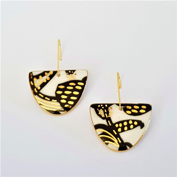 D Dangle porcelain earrings in black and white with 22 kt gold detailing
