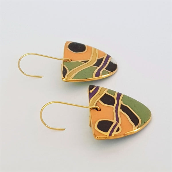 Porcelain D dangle earrings in green. orange and black with gold