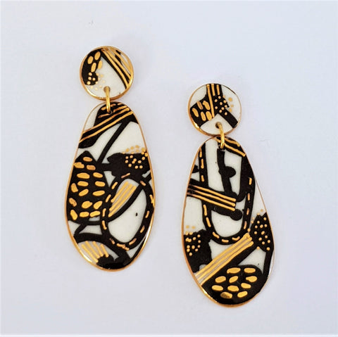 Porcelain statement earrings, white with abstract black and gold pattern