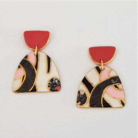 Double drop earrings with red tops in pink black and white.