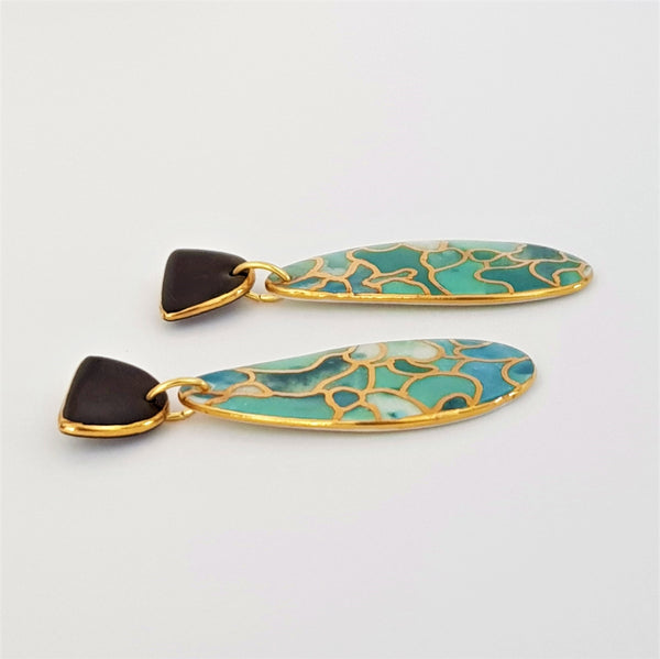 Double drop earrings with black tops and mermaid vibe tones.