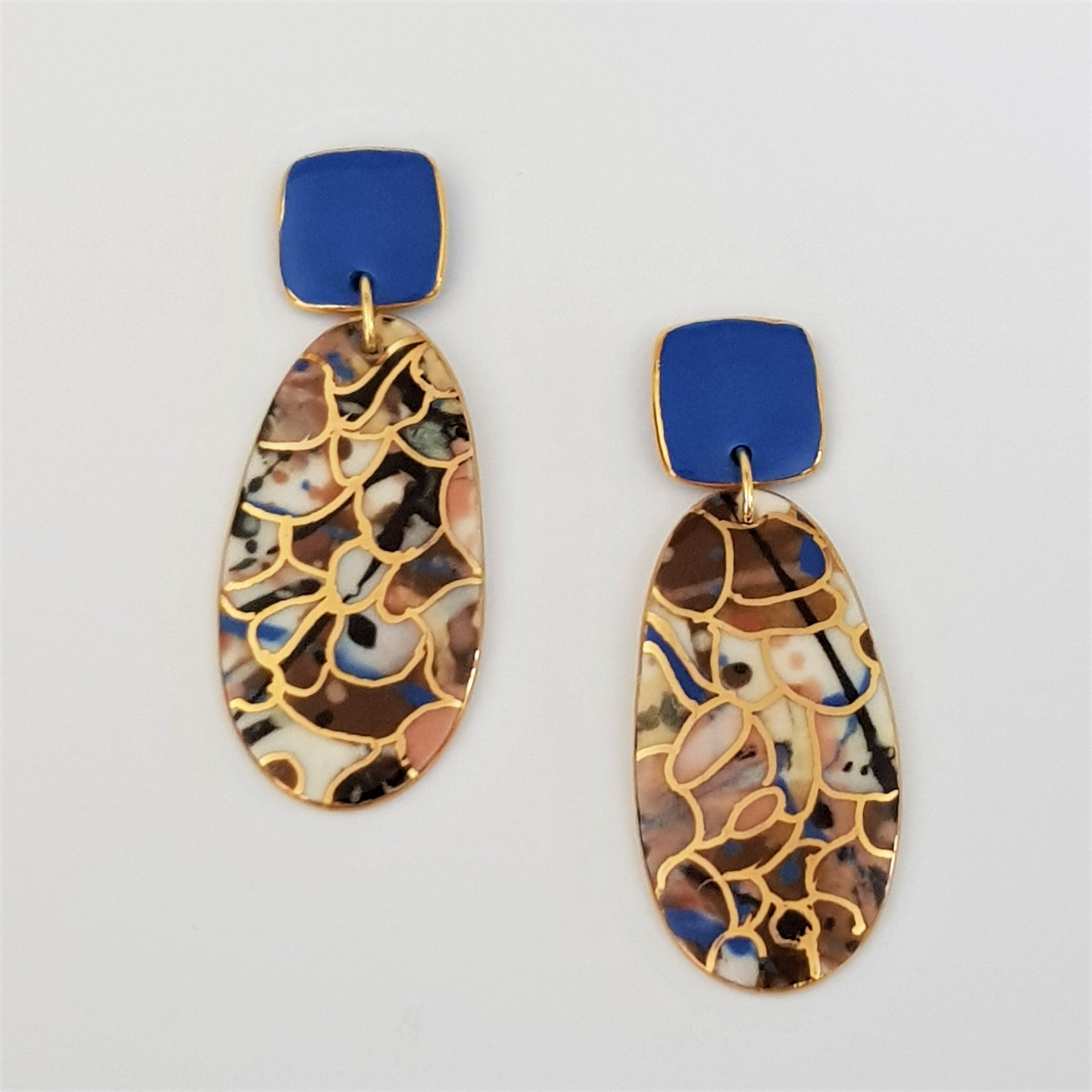 Double drops earrings. Square blue tops and earthy tones with gold.
