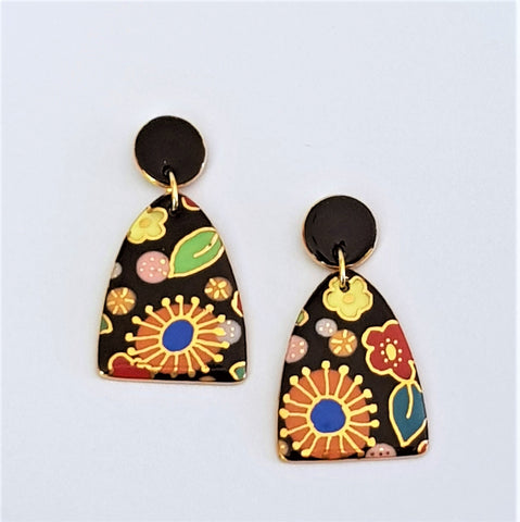 Mid sized double drop earrings in bright floral design with gold linework.
