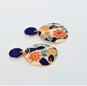 Porcelain statement drop earrings with stud tops and floral design with gold linework.