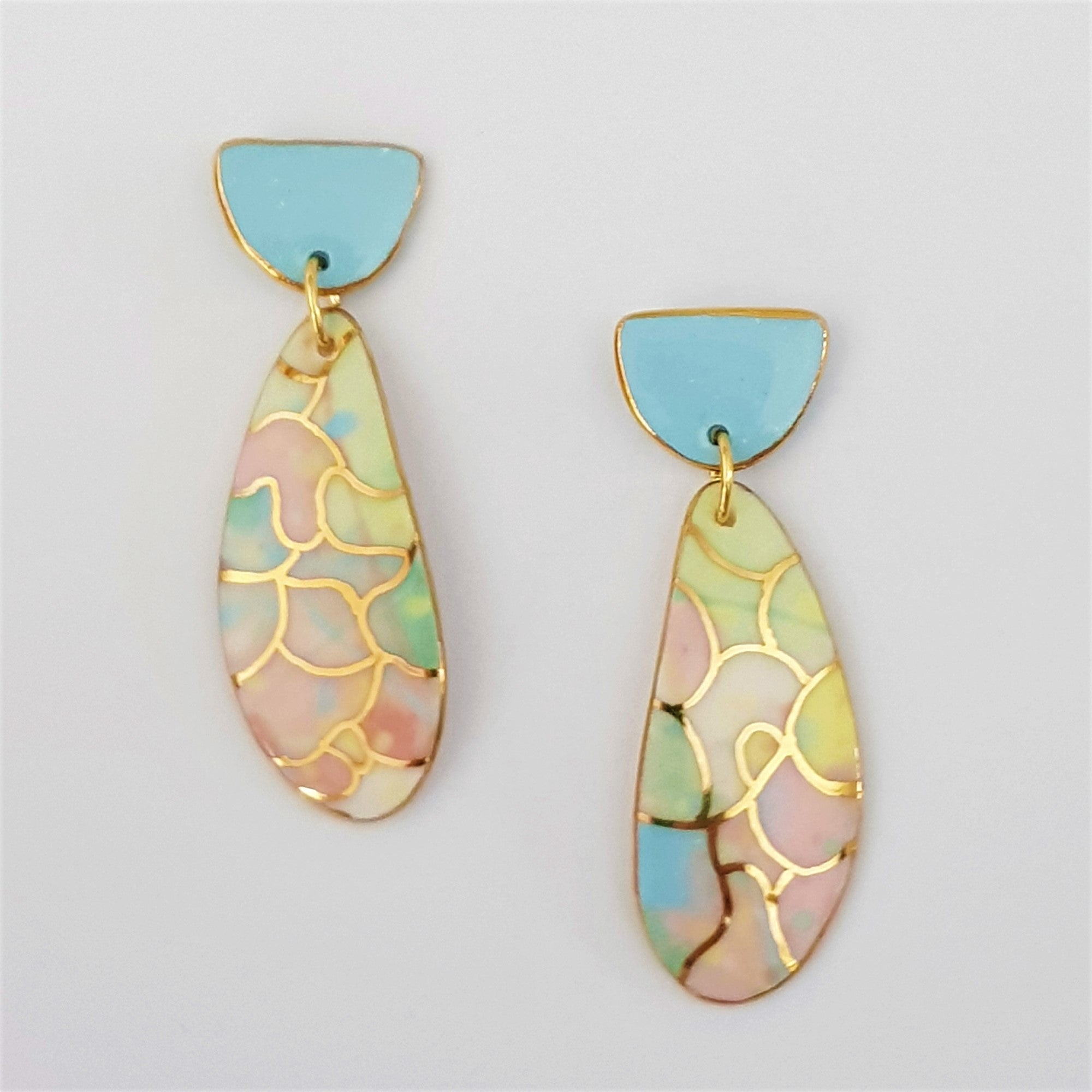 Double drop earrings. Feminine soft pastels with gold highlights.