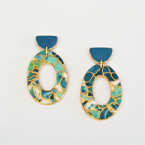 Large donut double drop statement earrings in teal and gold .