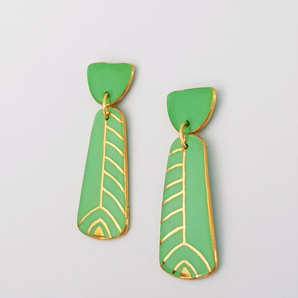 Mint double drop earrings with gold detailing.