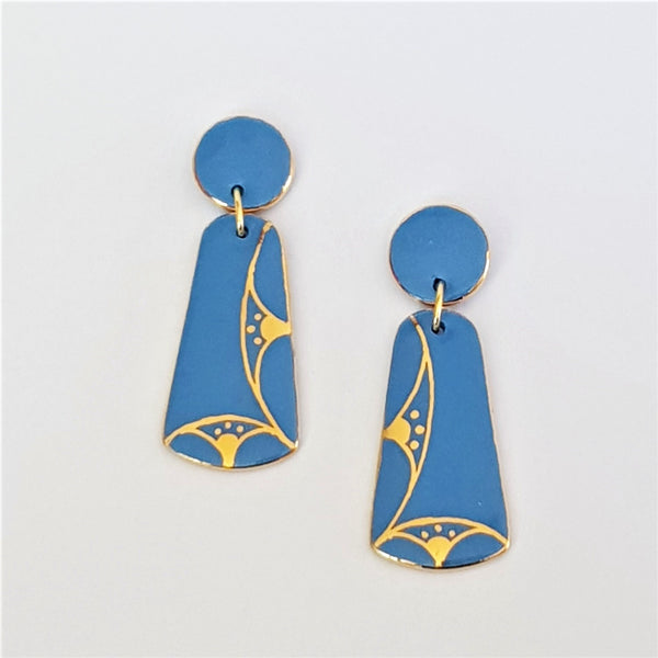 Mid blue double drop oblong earrings with gold linework and trim.