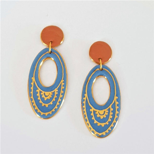Soft blue and peach oval drop earrings with gold highlights