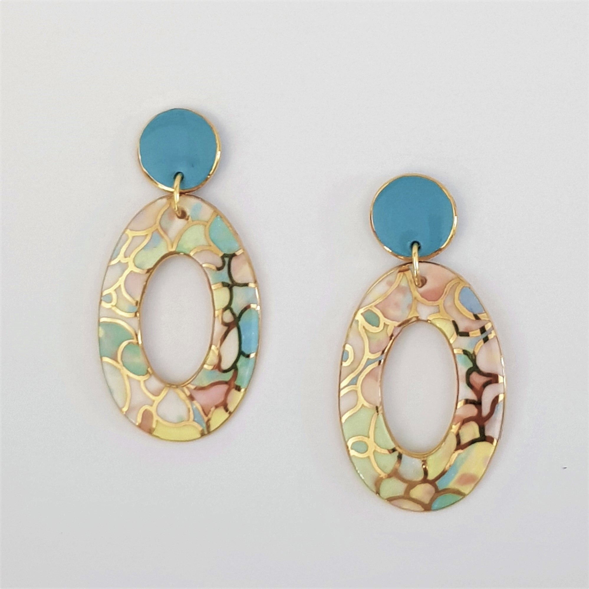 Large donut double drop statement earrings in soft pastels and gold .