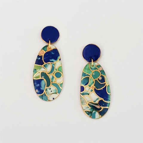 Double drops earrings. Blue and teal and blue tops with gold linework.