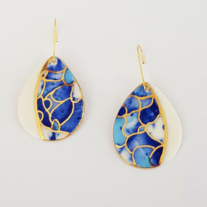 Drop earrings in blues with gold linework and white edge.