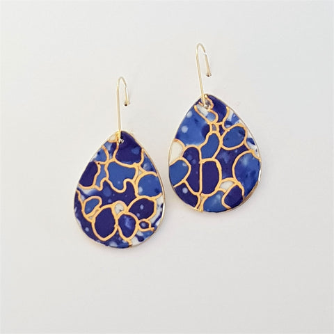 Drop earrings indigo mermaid vibes with gold linework.