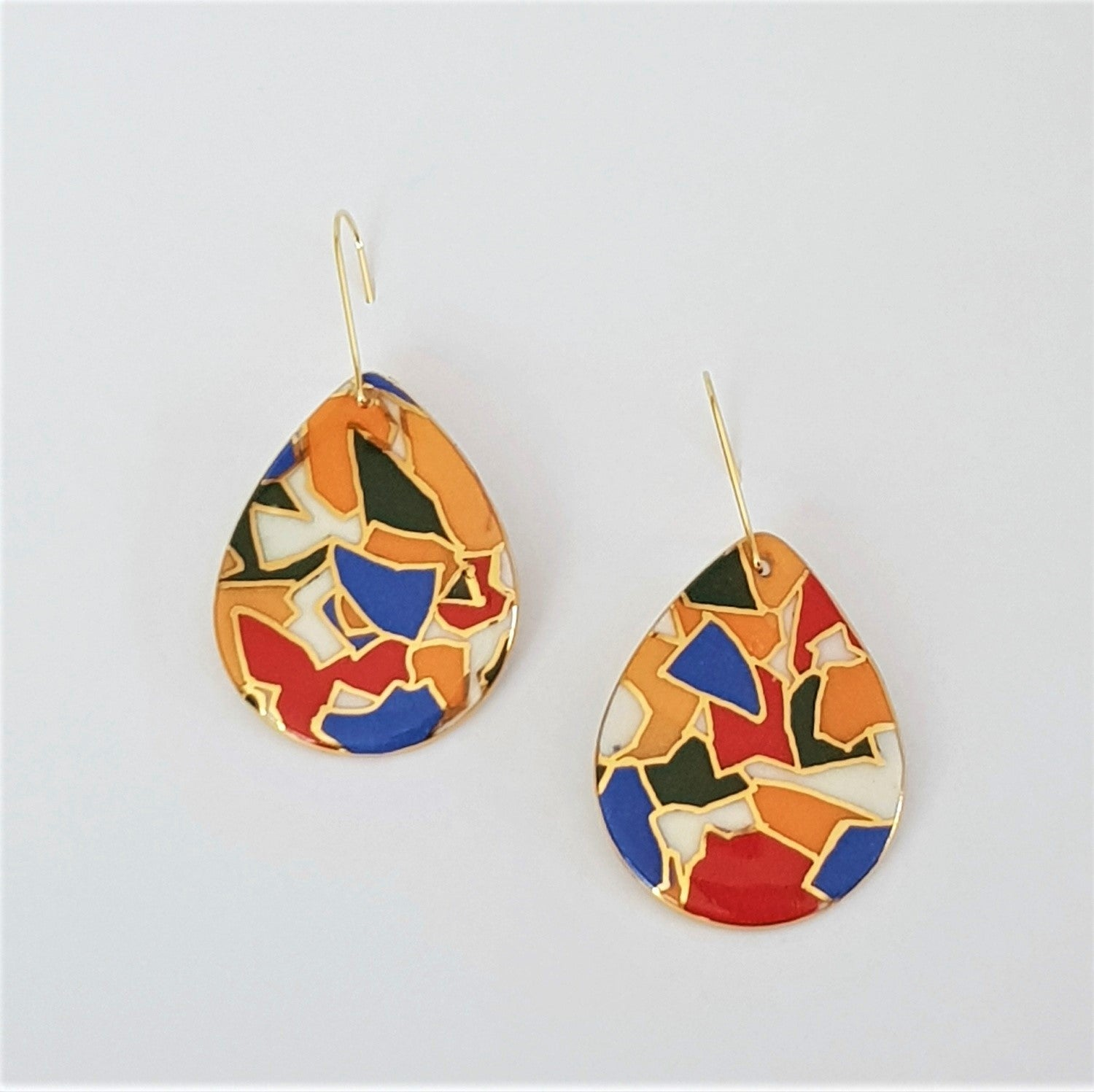 Drop style earrings in bright geometric pattern with gold