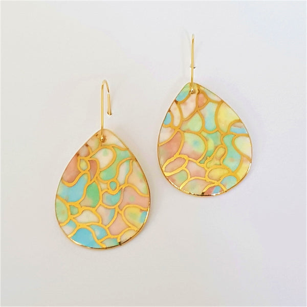 Drop earrings in pastel tones and gold linework.
